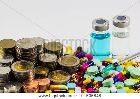 Medicine With Money And Syringe On White Background. Expensive Bill. Finance Concept Of Pharmacy Bus
