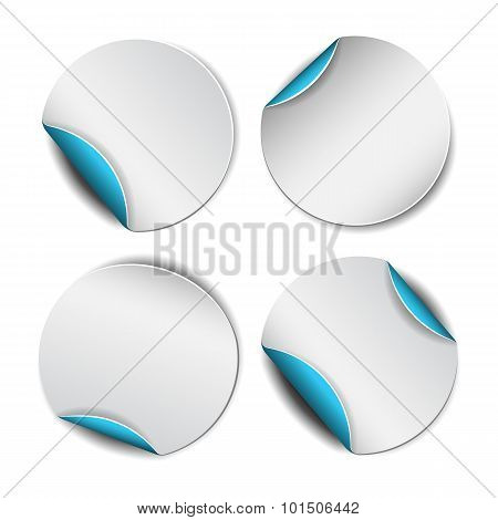 Set of white round stickers with blue backside.