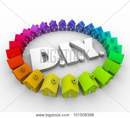 DIY letters for Do It Yourself surrounded by houses or homes to illustrate a handyman project, building task or construction improvement job