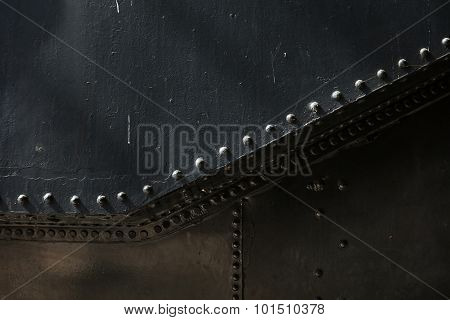 Metal background of old steam locomotive