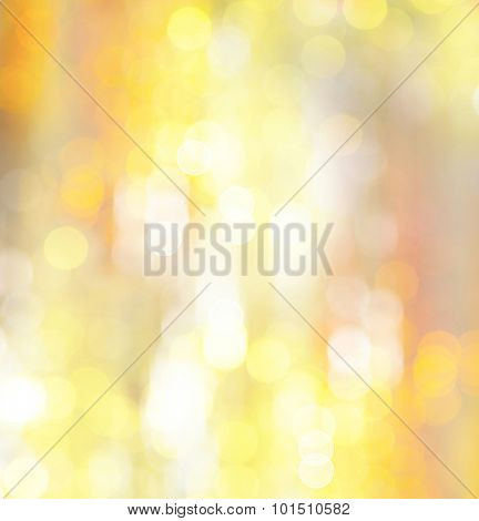 Gold background. Abstract holiday glowing golden background. Christmas Holiday glowing Abstract Glitter Defocused blinking lights. Blurred Bokeh. Photo
