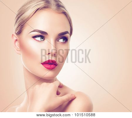Beautiful woman portrait. Beauty Spa girl with perfect fresh skin. Pure Beauty blonde model with holiday makeup. Youth and Skin Care Concept. Studio shot
