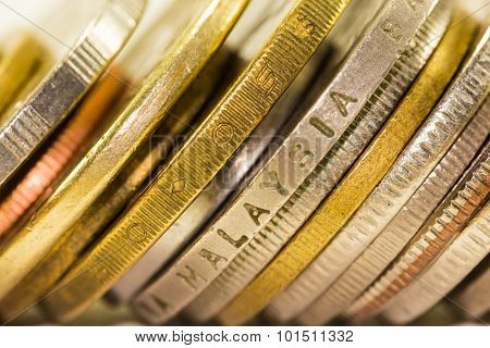 Golden Coins And Coins Stacked On Each Other In Different Positions