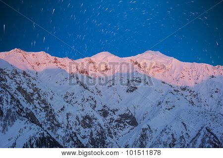 Star Trail with snow mountain