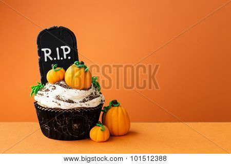 Halloween cupcake with copyspace to side