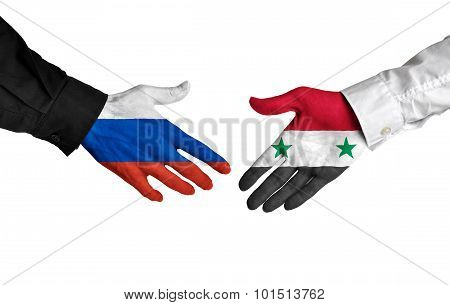 Russia and Syria leaders shaking hands on a deal agreement