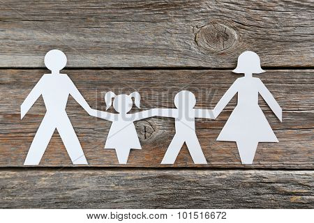 Happy Paper Family On Grey Wooden Background