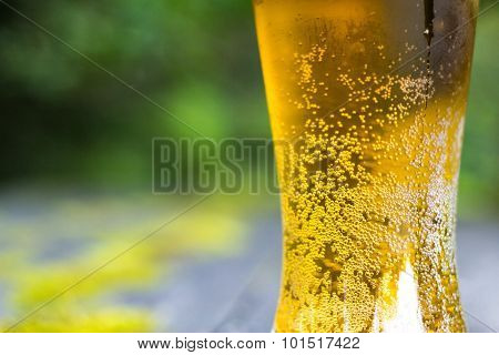 Glass of beer on old table outdoor