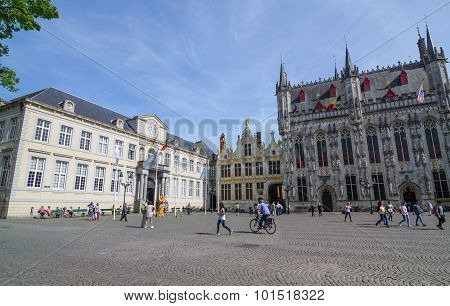 Bruges, Belgium - May 11, 2015: Tourist On Burg Square With City Hall In Bruges