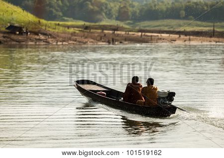 Buddhist Monks Collecting Alms In The Morning By Boat.