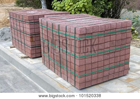 Two Stacks Of Concrete Pavement Tiles