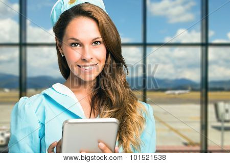 Flight hostess checking bookings on a tablet