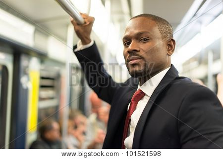 Portrait of a businessman traveling in the subway train