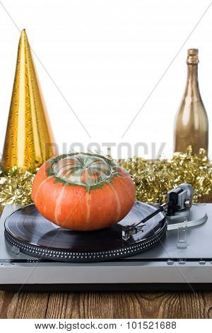 Shiny party hat with record player and pumpkin