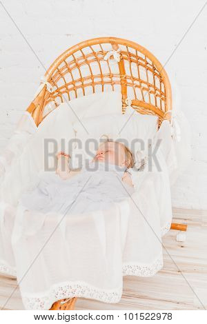Osier cradle with sleeping baby