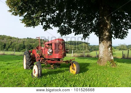 Old red tractor at the farm