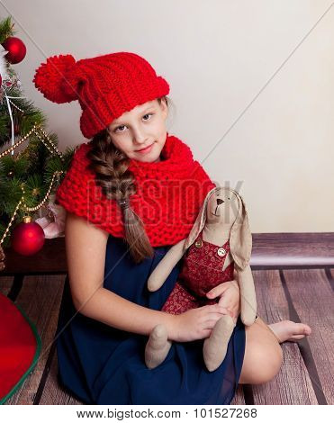 Girl holding big textile hare