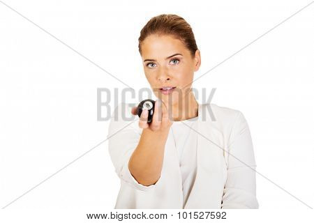 Happy businesswoman holding eight billiard ball. Winning concept.