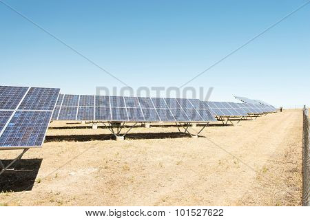 Panels of solar power station on the field.