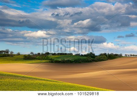 beautiful valley - colorful land and flowering field overlooking cloudy sky, farmland