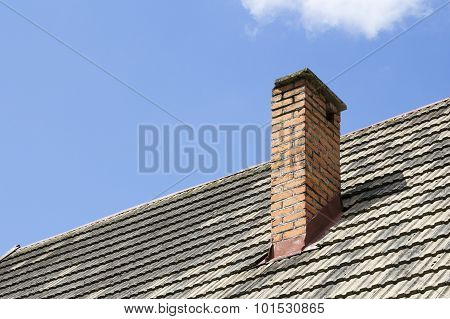 brick chimney on a roof