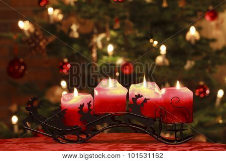 Advent Candles in Front of Christmas Tree