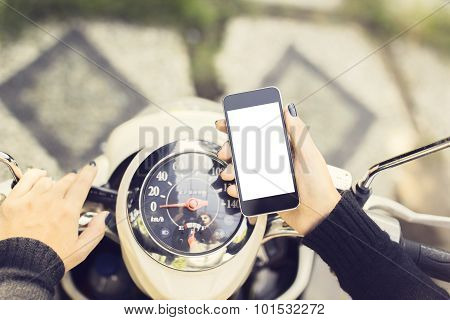 Hipster Girl With A Blank Phone And A Motorbike