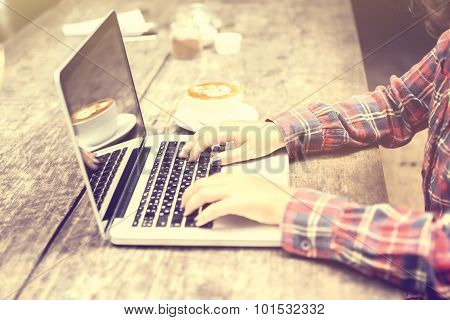 Hipster Girl Typing On A Laptop
