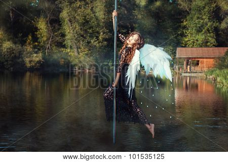 Girl With Angel Wings Dancing On The Pole.