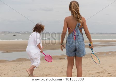 Kid And Grand Mother Playing On The Beach