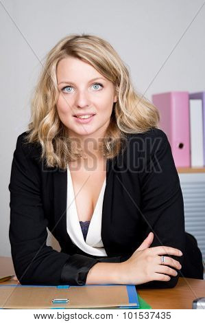 Successful Businesswoman Portrait At Work In Bright Office