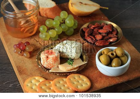 Rustic appetizer with cheese and fruits