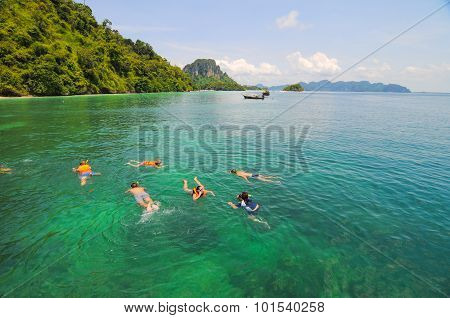 Tourists Snorkeling In A Tropical Clear Sea