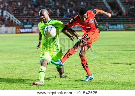 Sisaket Thailand-september 12: Adefolarin Durosinmi Of Sisaket Fc. (orange) Shooting Ball During Tha