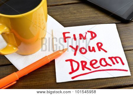 Find your dream - motivational handwriting on a napkin with a cup of coffee and phone
