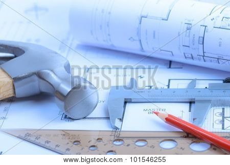 Architectural blueprints rolls and engineering items. Toned in blue. Soft light