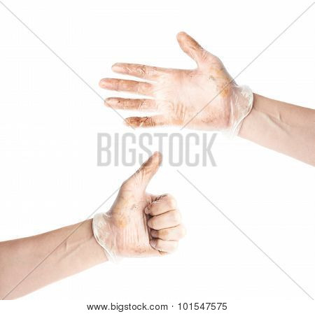 Workers hand in a dirty rubber glove