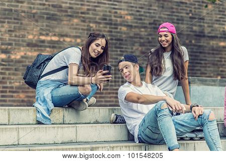 Skateboarder friends on the stairs made selfie photo