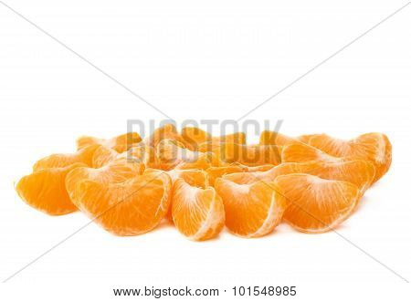 Surface covered with slice sections of tangerine isolated over the white background