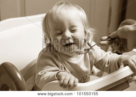 baby with a spoon
