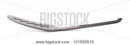 Used black plastic spatula isolated