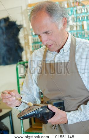 Cobbler mending shoe