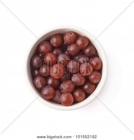 Bowl filled with the dark grapes