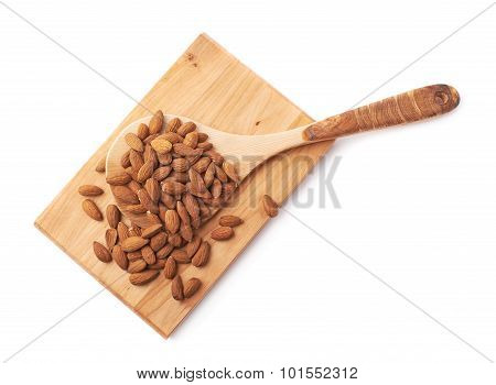 Wooden spoon covered with almonds