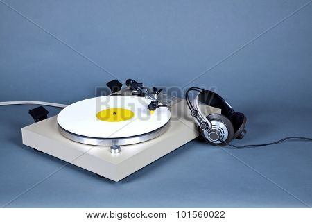 Analog Stereo Turntable Vinyl Record Player with White Disk and Headphones