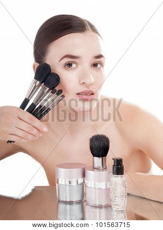 Woman With Healthy Complexion Is Holding Near The Face Make-up Brush Set.