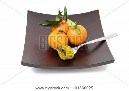 The Mandarins On The Plate Isolated On White
