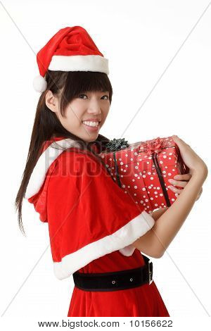 Happy Smiling Girl Holding Christmas Gift