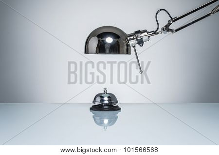 Lighting Up Hotel Bell For Calling Service With Desk Lamp