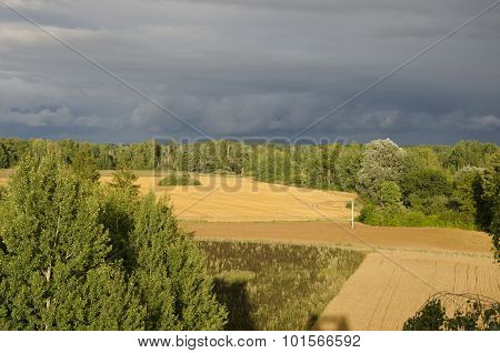 Country Farm Fields Under Stormy Sky